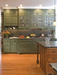 green cabinets and wood island. Would also work reversed. Add dad's tumbled stone backsplash and would be very rich and lovely