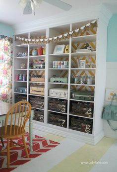 Lolly Jane's fun herringbone bookcase in their craft room! Love this space! @Lolly Jane {lollyjane.com}