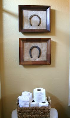 Framed horse shoes - perhaps ones from all those extra special horses. Except that they're upside down! Gotta have them right side up to keep all the luck in :)
