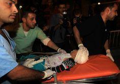 Palestinian medics wheel a wounded boy into the al-shifa hospital in Gaza City following an Israeli air strike on November 14, 2012. (MAHMUD HAMS - AFP/Getty Images)