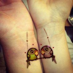 Parrots tattoos hand tattoos, bird tattoos, tattoo ideas, matching tattoos, wrist tattoos, friendship tattoos, sister tattoos, couple tattoos, friend tattoos