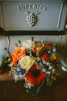 coral arrangement with hints of blue // photo by Hom Photography // http://ruffledblog.com/french-country-inspired-wedding