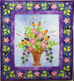 """""""July Bouquet"""" by Mary-Margaret Morton, 2009 IHQS 1st prize, wall quilts. Fusible machine applique with a blanket stitch; machine and hand embroidered. Free-motion quilted with silk and polyester threads."""