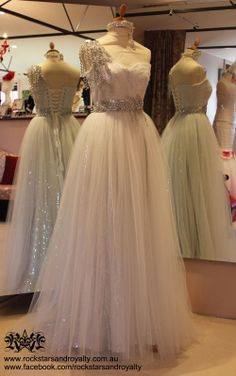 Silver sequin and ivory tulle corseted gown with jewelled rhinestone and Swarovski crystal detail on the waist and shoulder by Rockstars and Royalty.