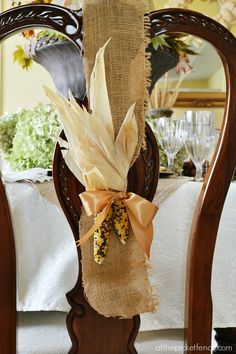 Indian corn and burlap ribbon chair wreath from atthepicketfence.com