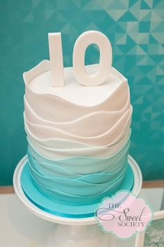 Gorgeous ruffle wave cake at a pool party!   See more party ideas at CatchMyParty.com!  #partyideas #pool
