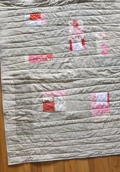 Linen quilt with blocks of patterned color