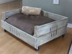 DIY pallet dog bed - love the wheels!