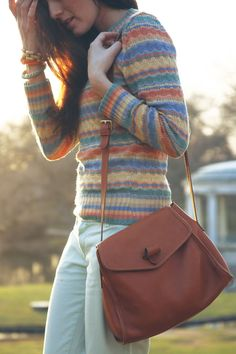 Sarah Vickers of Classy Girls Wear Pearls in a vintage sweater and J.Crew chinos