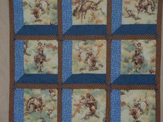 Quilt cowboy western, baby wall quilt, Attic Window, 38 square, Blue/Brown/Tan, FREE SHIPPING. $80.00, via Etsy.