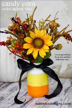 Use and upcycled mason jar to create this candy corn halloween flower vase!