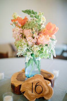 cut wood table numbers, photo by Al Gawlik Photography http://ruffledblog.com/pecan-springs-ranch-wedding #weddingideas #centerpieces #tablenumbers
