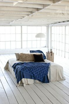 Someday I want my bed like this, in the center of a wide open space- but with a fireplace too.