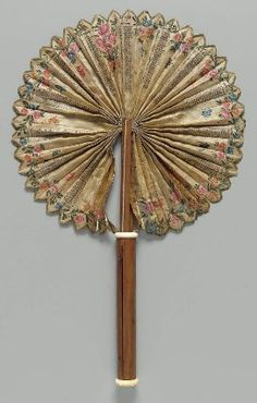 Calendar fan, French, 1774 Cockade calendar fan. Single white silk leaf, letter-press printed and painted in watercolor. Days of month listed for year 1774, painted floral swag border, butterflies between moths. Wood handle case with brass mechanism; ivory at ends of case.| Museum of Fine Arts, Boston
