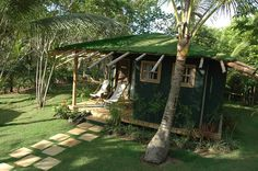 Grass roof over bamboo structure, hand made earthen tile floor, Chalet at butterfly house in Marau Brasil, design and architecture by Maison e Maison.