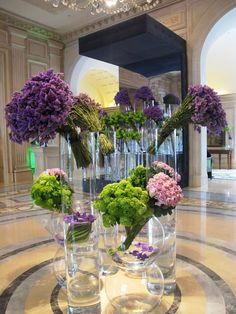 Arrangements in lobby of Four Seasons, Paris. Absolutely gorgeous, but I have to admit (this doesn't happen very often)- I have NO CLUE what the purple flowers are.  None.