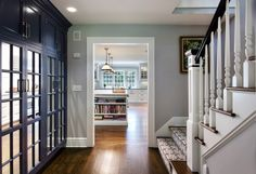 Pantry located by the back staircase in a Darien, CT, home designed by Robert A. Cardello Architects