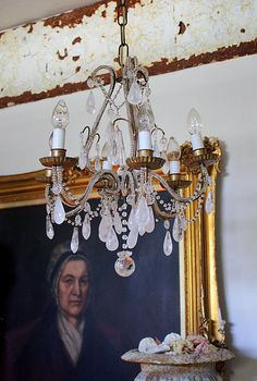 gold frames and antique paintings with Crystal Beaded Chandelier