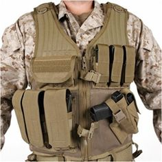BLACKHAWK Omega Elite Vest Cross Draw/Pistol Mag http://www.reactgear.com/Blackhawk-Omega-Elite-Vest-Cross-Draw-Pistol-Mag-p/30ev5-p.htm The BlackHawk Omega Elite Cross Draw Pistol Mag Vest consists of a combat-proven configuration witha cross draw holster and pouches for M16/M4 magazines as well as pistol magazines. Blackhawk Tactical Vests http://www.reactgear.com/Tactical-Vests-s/85.htm