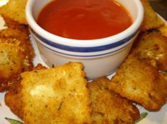 """Fried Ravioli  I got this recipe off of """"Everyday Italian"""" with Giada De Laurentiis.  TALK about GOOD!!  I made it for my husband (who is a ONLY meat and potatoes kind of guy) and he flipped!  It's even better than cheese sticks...and who can top that?"""