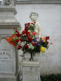 Fresh flowers on this old grave....
