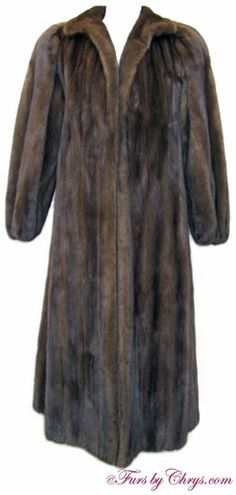 SOLD! Mahogany Mink Coat #MM709; Like New Condition; 6 - 10 Average or Petite. This is a gorgeous genuine natural mahogany mink fur coat. It has Herbert's Furs label and features a wing-style collar, lightly elasticized sleeve ends and built-in shoulder pads. It has an open design (no closures). Make special events even more memorable by dazzling them with this luxurious mahogany mink coat!