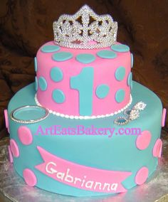 Custom unique blue and pink fondant polka dot girl's princess 1st birthday cake with toy tiara, earings and bracelet by arteatsbakery, via Flickr