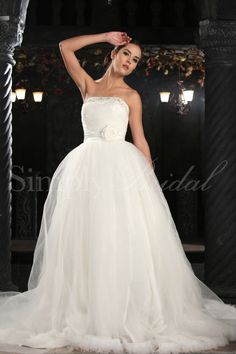 Ball gown with a strapless, straight neckline. Chapel train. Back zipper.