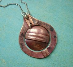 fold form pendant hand forged, copper. #suelacydesigns #metalsmith #foldform