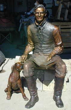 """""""Preparing for Greatness"""" Lincoln with a dog, by Steve Maxon and Doris Clark  Sculpture installed at Illinois College, Jacksonville, IL"""