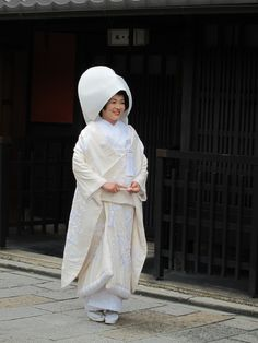 Woman in an uchikake-traditional japanese wedding gown