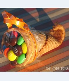 Sugar Cone Cornucopia. Ohhhh...you're gonna want to file this away for thanksgiving!! Using a sugar cone, dip the tip in warm water for about 20 seconds then microwave for 20 seconds. Roll the warm, moistened end around a clean pencil and hold for 20 seconds.  Voila...Mini Cornucopias:) Fill with whatever you like, use as a place card... Be creative!