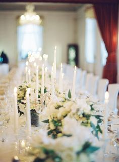 Beautiful white tablescape with taper candles