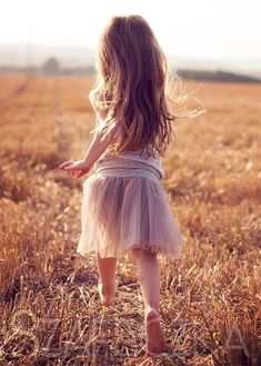 reminds me of me as a little girl at my grandma's. Always barefoot, running around with my hair everywhere.