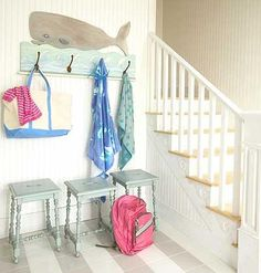 Stairways can be great makeshift mudrooms if outfitted with hooks for dirty towels in the summer and coats in the winter. Add a stool or bench for tying shoes just before running out the door.| Photo: Jean Allsopp | myhomeideas.com
