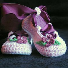 baby shoes flower and ribbon