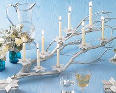 Twig Menorah - inspiration for a twiggy branch used as a candleholder ... I want to see a bit more decor detail, but I haven't decided what or how much. love this idea though. :)  #TwigCrafts #Crafts #Candles #Menorah - pb†å