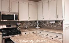 I should show this to our landlord to convince hm to let us paint the 60's cabinets :P We have the knockoff not-marble version of that counter top! I love that dusty white (Manchester Tan) aaaaand that backsplash! Now to find it in a removable tile :)