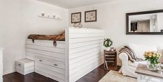 Platform bed with storage in a studio apartment