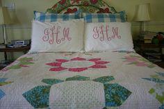monogram pillows with pom pom trim