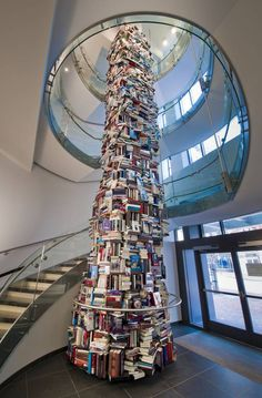 34-foot tower of books about abraham lincoln at ford's theater's center for education and leadership. the tower is comprised of 6,800 volumes of (aluminum replica) books about abraham lincoln. the majority of the titles are histories and biographies about lincoln. also included are books of lincoln's speeches, books of quotations or quips and one or two travel titles several children's titles also are included.
