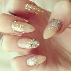 Nude nails with glitter.