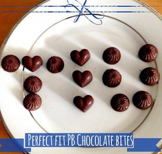 Perfect Fit PB Chocolate Bites shared by Cindyctiu! 1/2 cup coconut oil, melted; 1/4 cup unsweetened cocoa powder; 1/2 cup peanut butter; 2 tbsp honey; 3/4 scoop chocolate Perfect Fit Protein; 1 tbsp vanilla extract; and a pinch of sea salt. Mix all of the ingredients in a bowl. Pour mixture into chocolate molds and freeze for 30 minutes. Store in freezer.