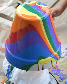 Pour Painting Garden Pots - Paint pot with white indoor/outdoor spray paint. When dry, turn upside down and drizzle rainbow colored acrylic paint from the bottle. (don't overdo, less is more!) The next day, paint the pot's lip & interior with one color of your choice of the acrylic paint when the pot is dry enough to be placed upright. Spray with polyurethane after pot is dry.  Great project