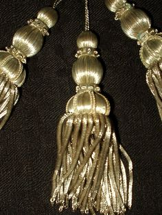 The Gatherings Antique Vintage - 3 Vintage 1920s Flapper Silver Metallic Spiral Wire Passementerie Tassels , $55.00 (http://store.the-gatherings-antique-vintage.net/3-vintage-1920s-flapper-silver-metallic-spiral-wire-passementerie-tassels/)