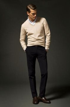 Beige v-neck sweater, white shirt, navy pants, brown shoes
