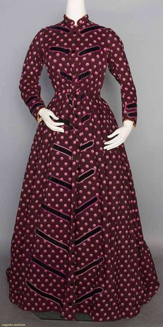 "PRINTED WOOL MATERNITY DRESS, 1860s 1-piece deep plum light weight wool printed w/ magenta & pink circles, diagonally place black velvet trim bands, black velvet buttons, skirt cartridged pleated at CB, loose F panels w/ drawstrings at W, brown cotton lining, B 36"", W up to 32"", L 56""-64"""
