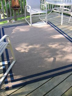 paint a plain outdoor rug $12 from Home store, use RustOleum, indoor/outdoor, American Accents Midnight Blue in satin. One pint (about $2.65)