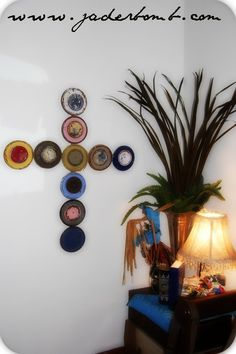 JADERBOMB - DIY: Paint Can Lid Cross - yes, put those old dried up paint can lids to use as art!!