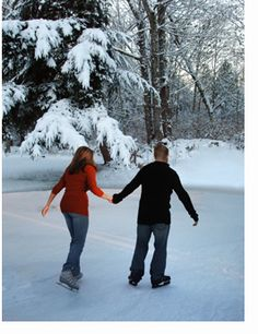 couple ice skating on pond